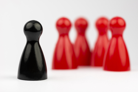 depict: Conceptual game pawns that depict the concept different