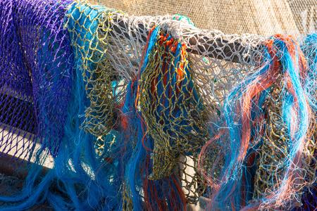fishing fleet: Colored fishing nets in a Dutch fishing port Stock Photo