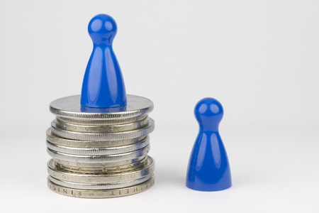 job posting: Conceptual financial position Represented play with colored pieces and coins Stock Photo