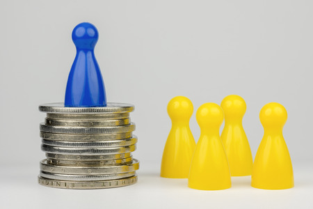 represented: Conceptual financial position Represented play with colored pieces and coins Stock Photo