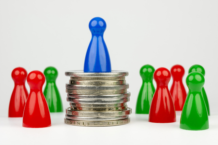 deviate: Conceptual financial position Represented play with colored pieces and coins Stock Photo