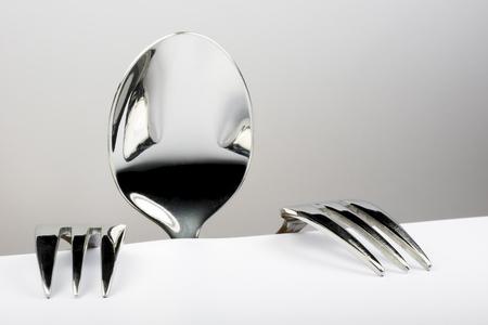 Figure de cuillère et deux fourches