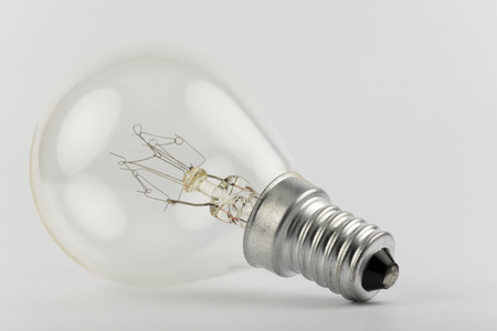 bygone: Old light bulb with artfully shaped filaments Stock Photo