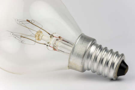 wrecked: Old light bulb with artfully shaped filaments Stock Photo