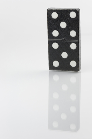 hooking: Standing black domino brick with white dots