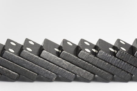 cleave: Composition of lying black domino bricks with white dots