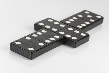 hooking: Composition of lying black domino bricks with white dots