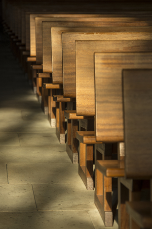 exalted: Pews in the morning light in a historic church in the Netherlands