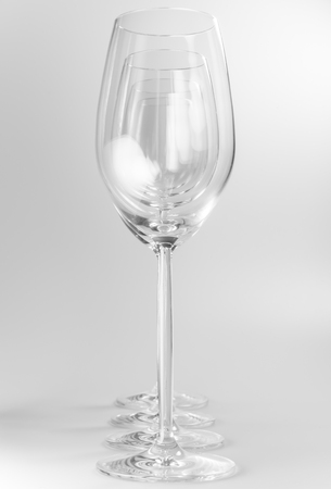 chalices: Four crystal wine glasses in a row Stock Photo