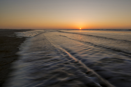 washup: Movement of waves on the beach at sunset Stock Photo