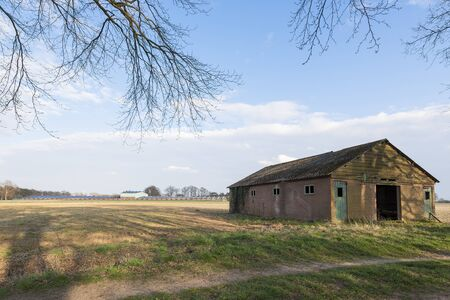 livestock sector: Modern barn with solar collectors and old barn Stock Photo