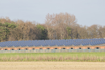 livestock sector: Modern barn with solar collectors on the roof Stock Photo