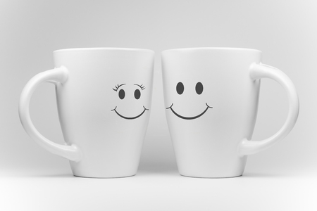 mirrored: Two white mugs in a mirrored arrangement in high key with facial expressions