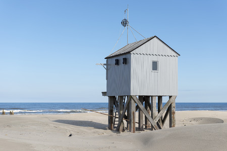 Famous authentic wooden beach hut for shelter, on the island of Terschelling in the Netherlands. Stock Photo
