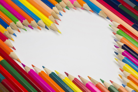 Collection of colorful pencils as a background picture in a heart shape Stock Photo