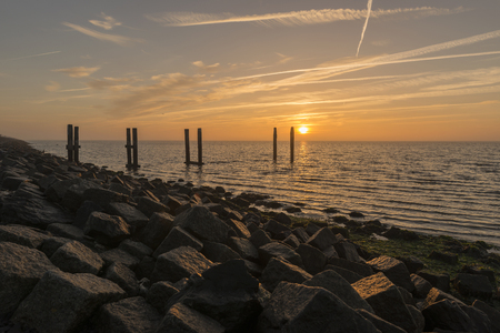 wadden: Sunrise above the Wadden Sea as seen from the dyke of Terschelling