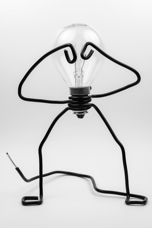 Emotional fantasy figure of a transparant light bulb and black electrical wires Stock Photo