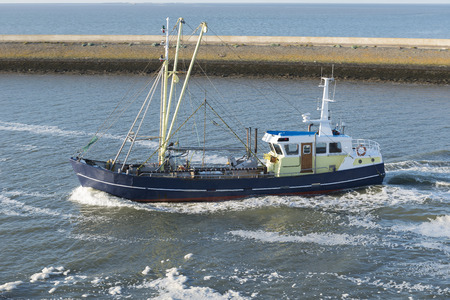 commercial fishing: Fishing boat entering the fishing port of Harlingen from the UNESCO protected Wadden Sea in the Netherlands
