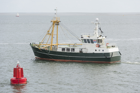 mussel: Fishing boat on the Wadden Sea near the island of Vlieland in the North of the Netherlands Stock Photo