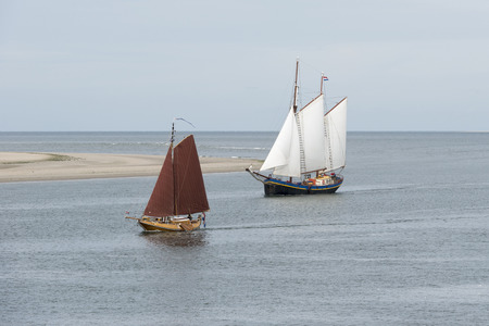 route master: Old historic sailing boats on the edge of the North Sea and Wadden Sea near the wadden Island Vlieland Stock Photo