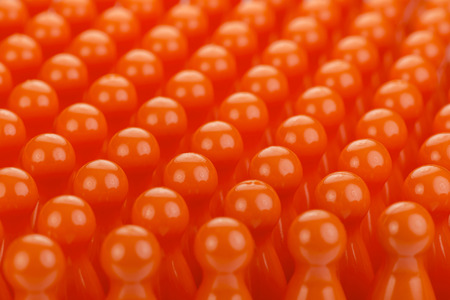 Conceptual orange game pawns as abstract view of a crowd Stock Photo