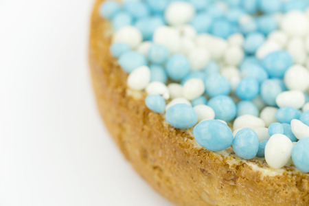 interspersed: Rusks with blue anise sprinkles is a Dutch tradition related to the celebration of the birth of a boy. Sprinkles are sugared anise seeds that serve as sweet toppings. Stock Photo