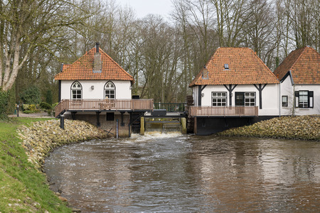 The recently restored historic water mill called The Olliemölle or Den Helder in the stream of the river the Boven-Slinge in Winterswijk in Hamlet the Achterhoek in the Netherlands. The water mill is a national monument and the restoration is completed