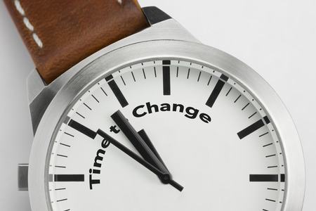 Analog watch with conceptual visualization of the text Time to Change Stock Photo