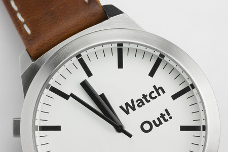 Analog watch with conceptual visualization of the text Watch Out Stock Photo