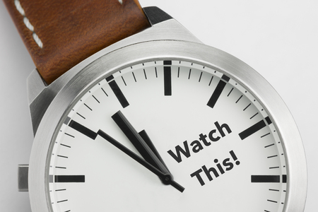 Analog watch with conceptual visualization of the text Watch This Stock Photo