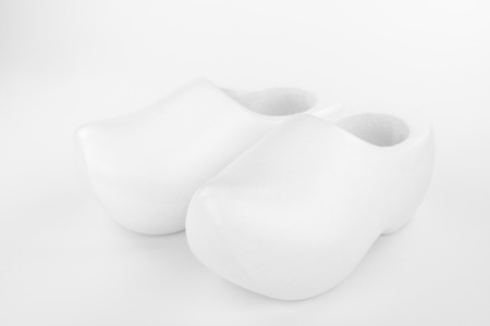 coverings: Two traditional Dutch white wooden shoes in a high key recording