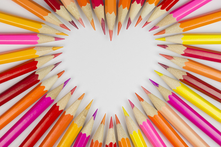 showy: Collection of colored pencils in heart shape in top view as background picture