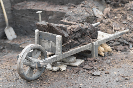 Old original wooden wheelbarrow for transporting stabbed peat blocks in the Netherlands