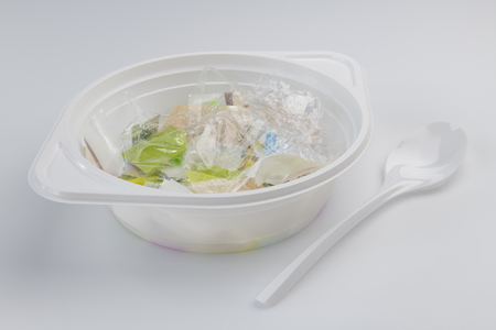 Conceptual visualization of the plastic soup problems by a plastic soup bowl filled with plastic and a plastic soup spoon 版權商用圖片