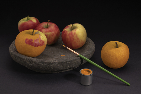Creative surreal still life of apples and oranges