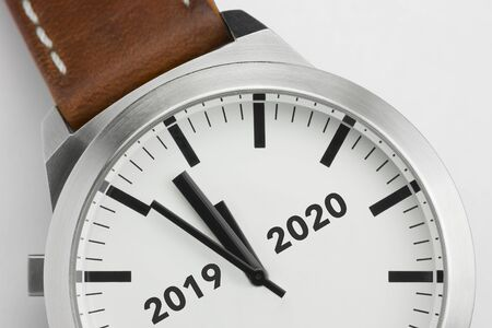 Wrist watch with black text 2019 to 2020 suggesting new year's eve