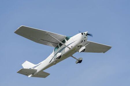 Single-engine sport airplane in a clear blue sky