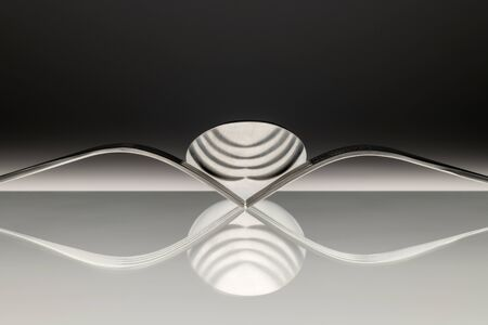 Abstract artistic picture of two forks and a spoon which is reflecting in the surface. Reklamní fotografie