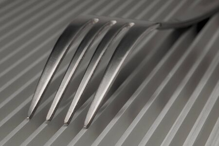 Abstract artistic picture of forks on a parallel grid structure