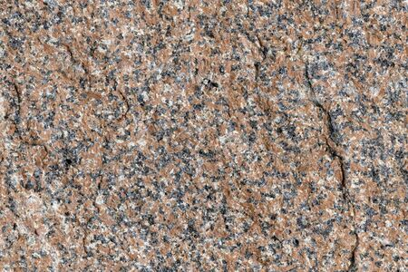 Granite in a brown-black shade as a full-screen background picture Stock Photo