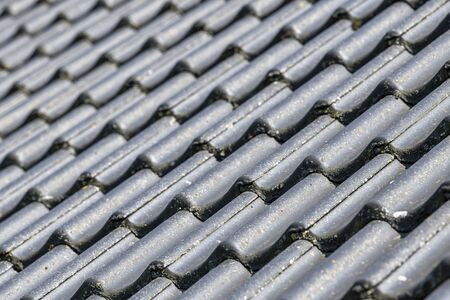 Pitched roof with black concrete tiles displayed full screen background picture