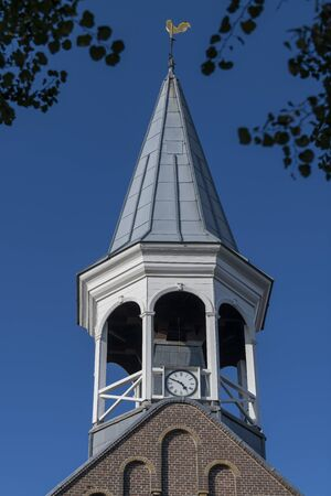 Historic wooden steeple of the church in the center of the village Midsland on the island of Terschelling in the northern Netherlands Reklamní fotografie