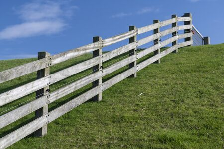 Wooden fence on the embankment of the seafront of the island of Terschelling in the northern Netherlands