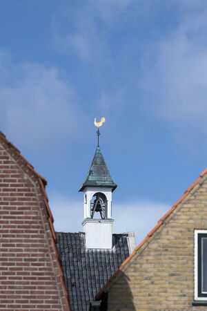 Steeple of a church in the village of West Terschelling on the island of Terschelling in the northern Netherlands