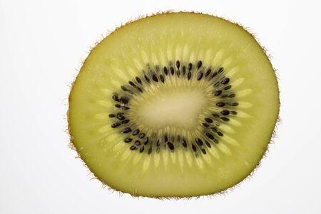 Slice of Kiwi fruit cut in backlight foto shot  Reklamní fotografie