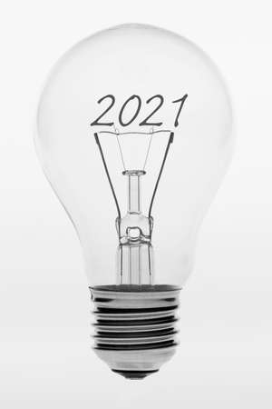 Isolated photo of an old-fashioned glass light bulb with the text two thousand and twenty one