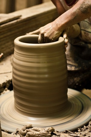 clay craft: ceramics, clay, craft, craftsman, earthenware, handicraft, home-made, jug, loam, master, pot, potter, pottery, skilled, trade, wheel, workman Stock Photo