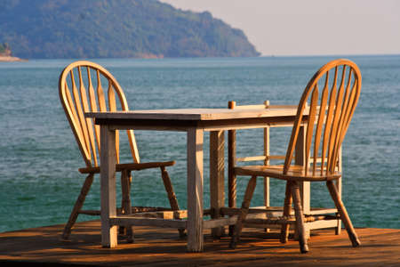Dining table on the shore near the sea Stock Photo