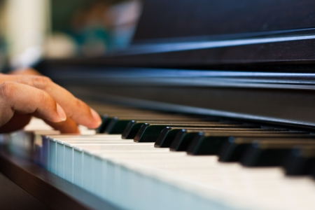 close up of male hands playing piano  photo