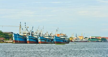 Fishing boats in a harbor  photo